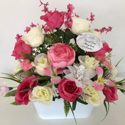 Hand made grave flowers arrangement in pink and white roses.
